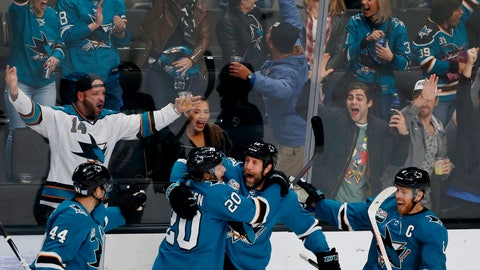 <p>               San Jose Sharks' Marc-Edouard Vlasic (44) and Marcus Sorensen (20) celebrate with teammate Joe Thornton, third from left, who scored his 400th career goal in the third period of an NHL hockey game against the Nashville Predators, in San Jose, Calif., Tuesday, Nov. 13, 2018. (AP Photo/Josie Lepe)             </p>