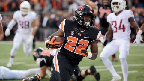 <p>               FILE- In this Oct. 6, 2018, file photo, Oregon State running back Jermar Jefferson (22) scores a touchdown during an NCAA college football in Corvallis, Ore. There's a pair of running backs in the state of Oregon that are making a case for Freshman of the Year honors: The Beavers' Jermar Jefferson and the Ducks' CJ Verdell. (AP Photo/Timothy J. Gonzalez, File)             </p>