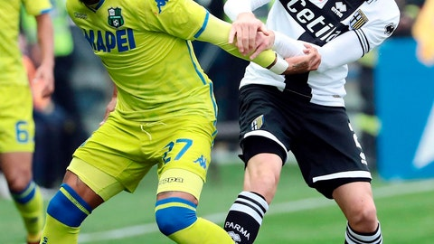 <p>               Parma's Simone Iacoponi, right, and Sassuolo's Kevin-Prince Boateng vie for the ball during a  Serie A soccer match between Parma and Sassuolo at Ennio Tardini Stadium in Parma, Italy, Sunday Nov. 25, 2018. (Elisabetta Baracchi/ANSA via AP)             </p>