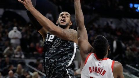 <p>               San Antonio Spurs forward LaMarcus Aldridge (12) shoots over Houston Rockets guard James Harden (13) during the second half of an NBA basketball game, Saturday, Nov. 10, 2018, in San Antonio. (AP Photo/Eric Gay)             </p>