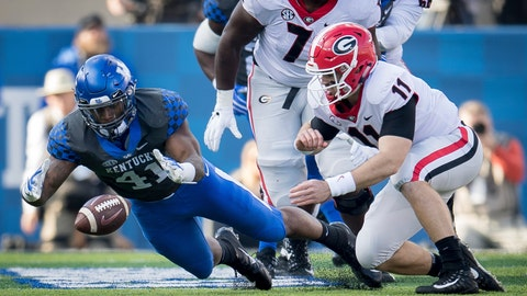 <p>               Kentucky linebacker Josh Allen (41) dives on the fumble of Georgia quarterback Jake Fromm (11) during the first half an NCAA college football game in Lexington, Ky., Saturday, Nov. 3, 2018. (AP Photo/Bryan Woolston)             </p>