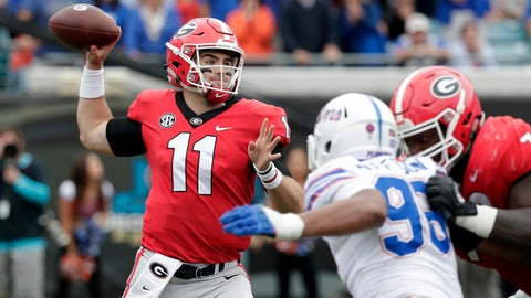 <p>               Georgia quarterback Jake Fromm (11) looks to throw a pass as Florida defensive lineman Cece Jefferson, right, rushes during the first half of an NCAA college football game Saturday, Oct. 27, 2018, in Jacksonville, Fla. (AP Photo/John Raoux)             </p>