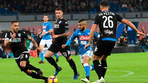 <p>               Napoli's forward Lorenzo Insigne, second from right, scores his side's first goal during the Italian Serie A soccer match between Napoli and Empoli at the San Paolo stadium in Naples, Italy, Friday, Nov. 2,  2018. (Ciro Fusco/ANSA via AP)             </p>