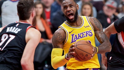 <p>               Los Angeles Lakers forward LeBron James, right, drives to the basket towards Portland Trail Blazers center Jusuf Nurkic during the first half of an NBA basketball game in Portland, Ore., Saturday, Nov. 3, 2018. (AP Photo/Craig Mitchelldyer)             </p>