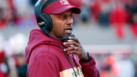 <p>               FILE- In this Nov. 3, 2018, file photo Florida State head coach Willie Taggart confers on his headset during the first half of an NCAA college football game against North Carolina State in Raleigh, N.C. The Seminoles have a chance to salvage their season against No. 13 Florida (8-3, No. 11 CFP) in Tallahassee on Saturday, Nov. 24. (AP Photo/Chris Seward, File)             </p>