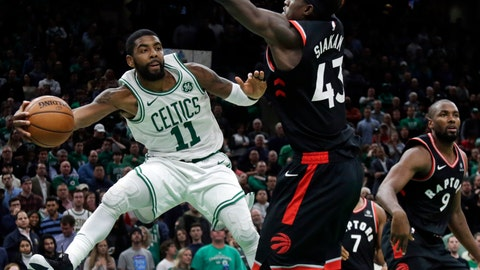 <p>               Boston Celtics guard Kyrie Irving (11) passes the ball against the defense of Toronto Raptors forwards Pascal Siakam (43) and Serge Ibaka (9) in the fourth quarter of an NBA basketball game, Friday, Nov. 16, 2018, in Boston. Irving scored 43 points to lead the Celtics to a 123-116 victory in overtime. (AP Photo/Elise Amendola)             </p>