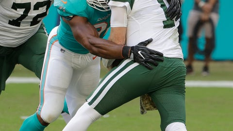 <p>               Miami Dolphins defensive end Cameron Wake (91) sacks New York Jets quarterback Sam Darnold (14), during the first half of an NFL football game, Sunday, Nov. 4, 2018, in Miami Gardens, Fla. New York Jets offensive tackle Brandon Shell (72) is on the left. (AP Photo/Lynne Sladky)             </p>