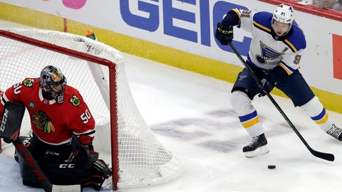 <p>               St. Louis Blues right wing Vladimir Tarasenko, right, looks to pass the puck as Chicago Blackhawks goalie Corey Crawford watches during the third period of an NHL hockey game Wednesday, Nov. 14, 2018, in Chicago. The Blackhawks won 1-0. (AP Photo/Nam Y. Huh)             </p>