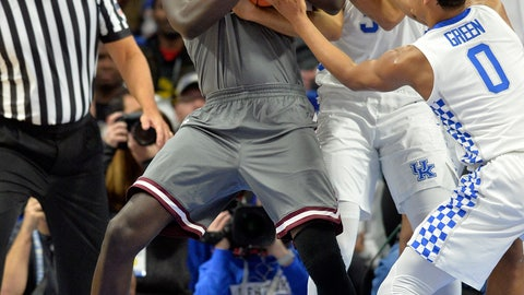 <p>               Southern Illinois forward Thik Bol (40) battles Kentucky guard Keldon Johnson (3) and guard Quade Green (0) for a rebound during the first half of an NCAA college basketball game in Lexington, Ky., Friday, Nov. 9, 2018. (AP Photo/Timothy D. Easley)             </p>