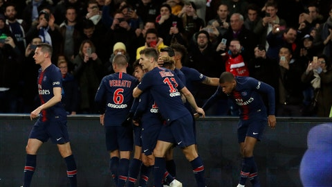 <p>               PSG's Kylian Mbappe, right, is congratulated by his team after he scored his side opening goal during the League One soccer match between Paris Saint-Germain and Lille at the Parc des Princes stadium in Paris, Friday, Nov. 2, 2018. (AP Photo/Thibault Camus)             </p>