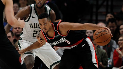 <p>               Portland Trail Blazers guard CJ McCollum, right, drives against Milwaukee Bucks forward Khris Middleton during the second half of an NBA basketball game in Portland, Ore., Tuesday, Nov. 6, 2018. The Trail Blazers won 118-103. (AP Photo/Steve Dipaola)             </p>