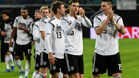 <p>               Germany's Niklas Suele, Leon Goretzka and Thomas Mueller, from right, claps hands to supporters after winning a friendly soccer match between Germany and Russia in Leipzig, Germany, Thursday, Nov. 15, 2018. (AP Photo/Jens Meyer)             </p>