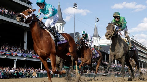 <p>               Florent Geroux, left, celebrates as he rides Monomoy Girl to victory as Joe Bravo, center, atop Blue Prize and Jose Ortiz, right, atop Wow Cat follow in the Breeders' Cup Distaff horse race at Churchill Downs, Saturday, Nov. 3, 2018, in Louisville, Ky. (AP Photo/Darron Cummings)             </p>