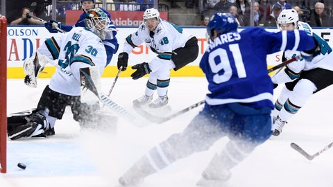 <p>               Toronto Maple Leafs center John Tavares (91) scores against San Jose Sharks goaltender Aaron Dell (30) during the first period of an NHL hockey game, Wednesday, Nov. 28, 2018, in Toronto. (Nathan Denette/The Canadian Press via AP)             </p>