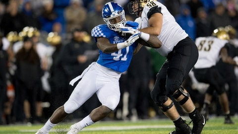 <p>               Kentucky linebacker Josh Allen (41) is held by Vanderbilt offensive lineman Justin Skule (58) during the second half of an NCAA college football game in Lexington, Ky., Saturday, Oct. 20, 2018. Kentucky won, 14-7. (AP Photo/Bryan Woolston)             </p>