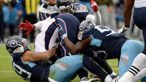 <p>               FILE - In this  Sunday, Nov. 11, 2018 file photo, New England Patriots quarterback Tom Brady, center, is sacked by a group of Tennessee Titans defenders in the second half of an NFL football game in Nashville, Tenn. Figuring out where the Titans are coming from defensively these days means a lot of film study, and not even that helps the way defensive coordinator Dean Pees has them lining up and switching responsibilities. (AP Photo/Mark Zaleski, File)             </p>