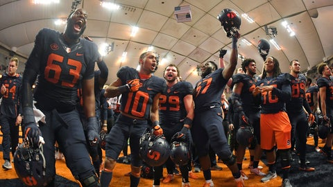 <p>               Syracuse players celebrate after defeating North Carolina State in an NCAA college football game in Syracuse, N.Y., Saturday, Oct. 27, 2018. (AP Photo/Adrian Kraus)             </p>