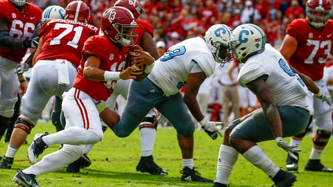<p>               Alabama quarterback Tua Tagovailoa (13) carries the ball as he tries to get around Citadel linebacker Willie Eubanks III (9) during the second half of an NCAA college football game, Saturday, Nov. 17, 2018, in Tuscaloosa, Ala. (AP Photo/Butch Dill)             </p>
