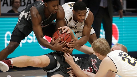 <p>               Santa Clara's Trey Wertz, top left, and Henrik Jadersten (3) wrestle for the ball against California's Paris Austin, top right, and Connor Vanover (23) during the second half of an NCAA college basketball game in Berkeley, Calif., Monday, Nov. 26, 2018. (AP Photo/Jeff Chiu)             </p>
