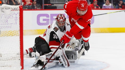 <p>               Arizona Coyotes goaltender Darcy Kuemper (35) stops a Detroit Red Wings center Andreas Athanasiou (72) shot in the second period of an NHL hockey game Tuesday, Nov. 13, 2018, in Detroit. (AP Photo/Paul Sancya)             </p>