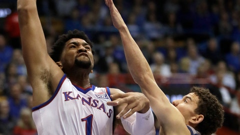 <p>               Kansas forward Dedric Lawson (1) drives on Washburn forward Will McKee (23) during the first half of a college basketball exhibition game in Lawrence, Kan., Thursday, Nov. 1, 2018. (AP Photo/Orlin Wagner)             </p>