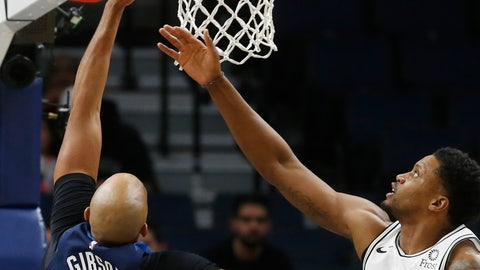<p>               Minnesota Timberwolves' Taj Gibson, left, lays up as San Antonio Spurs' Rudy Gay watches in the first half of an NBA basketball game Wednesday, Nov. 28, 2018, in Minneapolis. (AP Photo/Jim Mone)             </p>