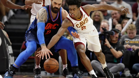 <p>               Cleveland Cavaliers' Collin Sexton (2) and Oklahoma City Thunder's Steven Adams (12),  of New Zealand, reach for the ball during the first half of an NBA basketball game Wednesday, Nov. 7, 2018, in Cleveland. (AP Photo/Tony Dejak)             </p>