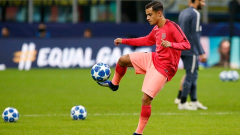 <p>               Barcelona's Philippe Coutinho warms up prior to the Champions League group B soccer match between Inter Milan and Barcelona at the San Siro stadium in Milan, Italy, Tuesday, Nov. 6, 2018. (AP Photo/Antonio Calanni)             </p>
