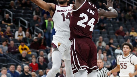 <p>               Arizona State's Kimani Lawrence (14) shoots around Mississippi State's Abdul Ado (24) during the first half of a NCAA college basketball game Monday, Nov. 19, 2018, in Las Vegas. (AP Photo/John Locher)             </p>