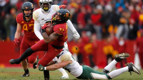 <p>               Iowa State running back David Montgomery, front left, runs the ball as he is tackled by Baylor linebacker Clay Johnston, right, during the first half of an NCAA college football game, Saturday, Nov. 10, 2018, in Ames. (AP Photo/Matthew Putney)             </p>