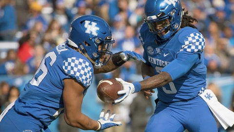 <p>               Kentucky quarterback Terry Wilson (3) hands the ball off too running back Benny Snell Jr. (26) during the first half of an NCAA college football game against Middle Tennessee in Lexington, Ky., Saturday, Nov. 17, 2018. (AP Photo/Bryan Woolston)             </p>