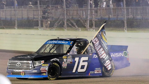 <p>               Brett Moffitt drives with a flag after winning the NASCAR Truck Series auto racing season title, at Homestead-Miami Speedway in Homestead, Fla., Friday, Nov. 16, 2018. (AP Photo/Terry Renna)             </p>