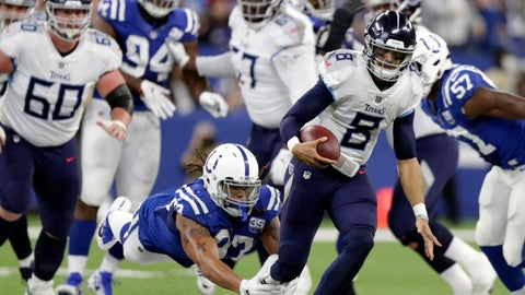 <p>               Tennessee Titans quarterback Marcus Mariota (8) runs out of a tackle by Indianapolis Colts' Jabaal Sheard (93) during the first half of an NFL football game, Sunday, Nov. 18, 2018, in Indianapolis. (AP Photo/Michael Conroy)             </p>