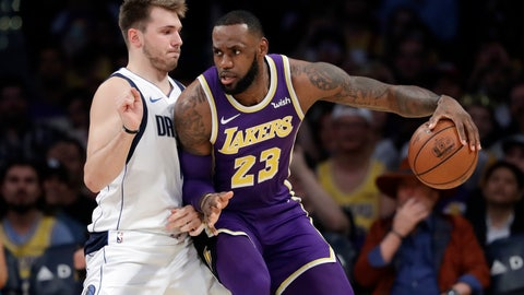 <p>               Los Angeles Lakers' LeBron James (23) is defended by Dallas Mavericks' Luka Doncic during the first half of an NBA basketball game Wednesday, Oct. 31, 2018, in Los Angeles. (AP Photo/Marcio Jose Sanchez)             </p>