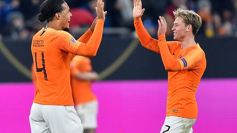 <p>               Netherland's Virgil Van Dijk, left, and Netherland's Frenkie De Jong celebrate after the UEFA Nations League soccer match between Germany and The Netherlands in Gelsenkirchen, Monday, Nov. 19, 2018. The match ended 2-2. (AP Photo/Martin Meissner)             </p>