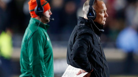 <p>               Miami head coach Mark Richt, right, watches from the sidelines during the second half of an NCAA college football game against Boston College in Boston, Friday, Oct. 26, 2018. (AP Photo/Michael Dwyer)             </p>