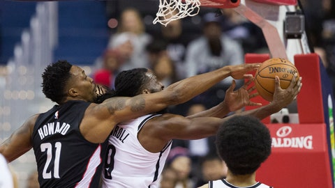 <p>               Washington Wizards center Dwight Howard (21) fouls Brooklyn Nets forward DeMarre Carroll (9) as Carroll shoots during the first half of an NBA basketball game Friday, Nov. 16, 2018, in Washington. (AP Photo/Alex Brandon)             </p>