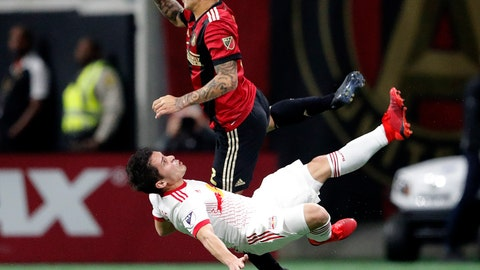 <p>               Atlanta United defender Franco Escobar (2) and New York Red Bulls defender Connor Lade (5) fight for control of the ball during an MLS soccer playoff game Sunday, Nov. 25, 2018, in Atlanta, (AP Photo/John Bazemore)             </p>