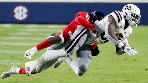 <p>               Mississippi State tight end Farrod Green (82) pulls in a pass reception against Mississippi defensive back Zedrick Woods (36) during the first half of an NCAA college football game in Oxford, Miss., Thursday, Nov. 22, 2018. (AP Photo/Rogelio V. Solis)             </p>
