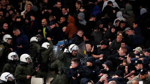 <p>               Greek riot police clash with Ajax fans before the start of a Group E Champions League soccer match between AEK Athens and Ajax at the Olympic Stadium in Athens, Tuesday, Nov. 27, 2018. (AP Photo/Thanassis Stavrakis)             </p>
