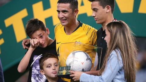 <p>               Australia's Tim Cahill, center, celebrates with his children, Kyah, second right, Shae, left, Sienna, right, and Cruz, after playing his final game for Australia following their win over Lebanon in an international soccer friendly in Sydney, Tuesday, Nov. 20, 2018. (AP Photo/Rick Rycroft)             </p>