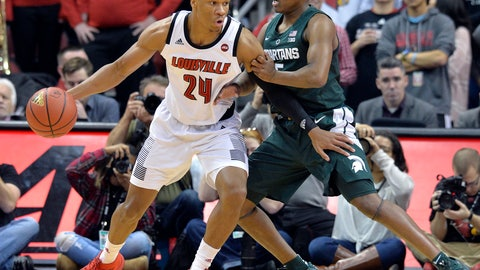 <p>               Louisville forward Dwayne Sutton (24) attempts to work his way around the defense of Michigan State guard Cassius Winston (5) during the first half of an NCAA college basketball game, in Louisville, Ky., Tuesday, Nov. 27, 2018. (AP Photo/Timothy D. Easley)             </p>
