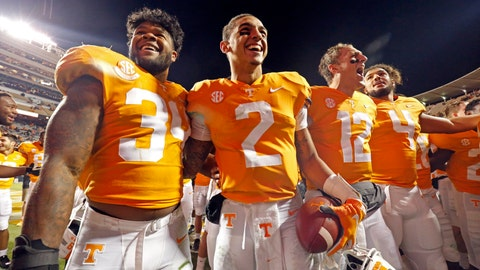 <p>               Tennessee quarterback Jarrett Guarantano (2) celebrates with teammates linebacker Darrin Kirkland Jr. (34), quarterback JT Shrout (12), and tight end Dominick Wood-Anderson (4) an NCAA college football game against Kentucky Saturday, Nov. 10, 2018, in Knoxville, Tenn. Tennessee won 24-7. (AP Photo/Wade Payne)             </p>