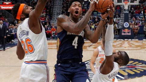 <p>               New Orleans Pelicans guard Elfrid Payton (4) goes to the basket between New York Knicks center Mitchell Robinson (26) and guard Tim Hardaway Jr. (3) in the first half of an NBA basketball game in New Orleans, Friday, Nov. 16, 2018. (AP Photo/Gerald Herbert)             </p>
