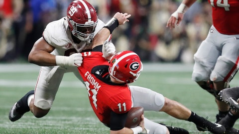<p>               FILE - In this Jan. 8, 2018, file photo, Alabama's Raekwon Davis, top, sacks Georgia's Jake Fromm during the second half of the College Football Playoff National Championship football game in Atlanta. Saturday's SEC Championship, is the game the Bulldogs have wanted since last January, when the Alabama pulled out a 26-23 overtime victory in the national championship game. (AP Photo/David Goldman, File)             </p>