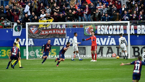 <p>               Deportivo SD Eibar's Sergi Enrich, center, scores his team's second goal of the game as Real Madrid's goalkeeper Thibaut Courtois, gestures during the Spanish La Liga soccer match between Real Madrid and SD Eibar at Ipurua stadium, in Eibar, northern Spain, Saturday, Nov. 24, 2018. (AP Photo/Alvaro Barrientos)             </p>