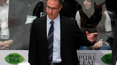 <p>               FILE - In this March 22, 2018, filer photo, Los Angeles Kings coach John Stevens gestures to his team during the third period against the Colorado Avalanche in an NHL hockey game in Denver. Stevens has been fired by the struggling Kings just 13 games into his second season in charge. (AP Photo/David Zalubowski, File)             </p>