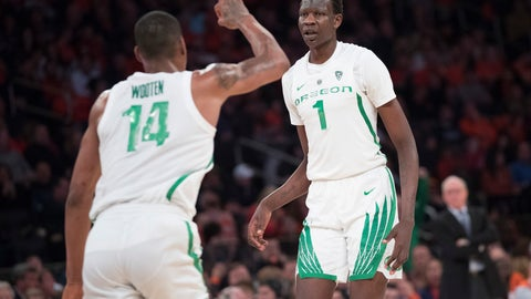 <p>               Oregon forward Kenny Wooten (14) and center Bol Bol (1) react after Bol Bol scored a three-point goal during the second half of an NCAA college basketball consolation game against Syracuse in the 2K Empire Classic, Friday, Nov. 16, 2018, at Madison Square Garden in New York. (AP Photo/Mary Altaffer)             </p>