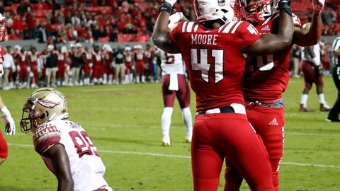 <p>               North Carolina State's Teshaun Smith (20) celebrates with Isaiah Moore (41) after he broke up a pass in the end zone intended for Florida State's Keith Gavin (89) during the second half of an NCAA college football game in Raleigh, N.C., Saturday, Nov. 3, 2018. (AP Photo/Chris Seward)             </p>