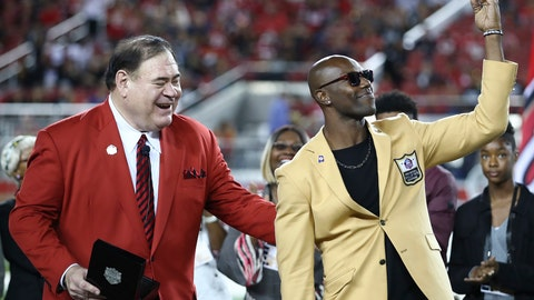 <p>               Former NFL wide receiver Terrell Owens, right, holds up his Hall of Fame ring presented by Pro Football Hall of Fame President David Baker, left, during halftime of an NFL football game between the San Francisco 49ers and the Oakland Raiders in Santa Clara, Calif., Thursday, Nov. 1, 2018. (AP Photo/Ben Margot)             </p>